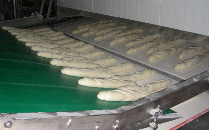 Baguette bread at the outfeed of the stabilized boards proofer Alitech